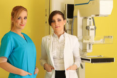 Two beautiful female doctors at work Royalty Free Stock Photography
