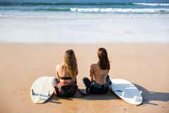 Surfer girls at the beach Royalty Free Stock Image