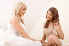 Two beautiful female friends gossiping Stock Photo