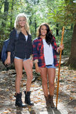 Two beautiful female hikers in the woods Royalty Free Stock Photos