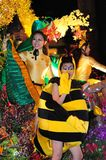 Two beautiful female performers in costumes. Beautiful performers dressed colourfully in parade costumes for the Chingay parade Stock Images
