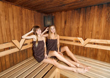 Two beautiful females in sauna. Royalty Free Stock Image