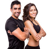 Two beautiful fitness instructors. Fitness instructors posing over white background Royalty Free Stock Photography
