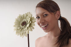 Two beautiful Flowers. A soft and delicate picture of a beautiful girl and a sunflower. Smiling and joyful Stock Images