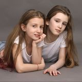 Two beautiful, funny friends, 9 years old, on a photo shoot in the studio stock images