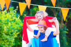 Two beautiful funny kids Dutch football supporters Royalty Free Stock Photography