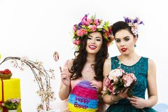 Two beautiful girl friends with candy and flower decoration. sty Stock Photography