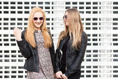 Two beautiful girl friends having fun outside in the city. Friendship and urban lifestyle Stock Images