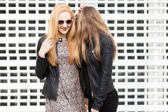 Two beautiful girl friends having fun outside in the city. Friendship and urban lifestyle Royalty Free Stock Image
