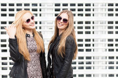 Two beautiful girl friends having fun outside in the city. Friendship and urban lifestyle Stock Photo