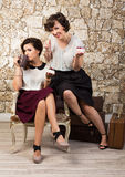 Two beautiful girl friends having tea. Party Stock Images