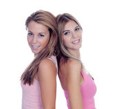 Two beautiful girl friends in pink. Isolated on a white background Royalty Free Stock Photos