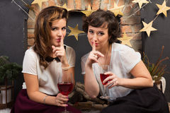 Two beautiful girl friends. Sharing secrets Royalty Free Stock Image