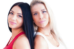 Two beautiful girl friends or sisters isolated over white background Royalty Free Stock Photos
