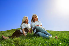 Two beautiful girl on the hill Stock Image