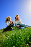 Two beautiful girl on the hill Stock Images