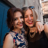 Two beautiful girl hugging each other, looking at camera. Closeup photo of strong true friendship of beautiful girls. Outdoor life royalty free stock photo