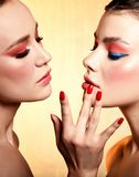 Two beautiful girl portrait with coral color makeup.  royalty free stock images
