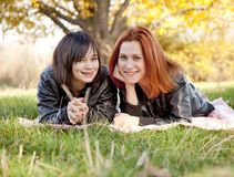 Two beautiful girlfriends at the autumn park Stock Photo