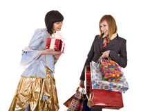 Two beautiful girlfriends enjoy shopping. Stock Photos