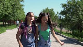 Two girls girlfriends running around holding hands having a good mood. slow motion. Two beautiful girlfriends girlfriends running around holding hands having a stock footage