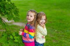 Two beautiful girlfriends posing in the garden Royalty Free Stock Images
