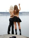 Two beautiful girls 5. Two beautiful young girls on the background of the river 5 Stock Photos