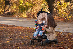 Two beautiful girls in the autumn park, sisters Stock Photography