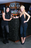 Two beautiful girls in bar Stock Photo