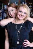 Two beautiful girls in bar Stock Photography