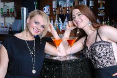 Two beautiful girls in bar Royalty Free Stock Photography