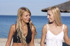 Two beautiful girls on a beach stock image