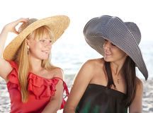 Two beautiful girls at beach Stock Photos