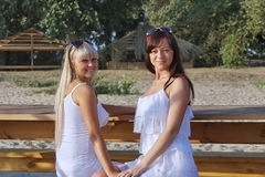 Two beautiful girls on a bench Royalty Free Stock Photo