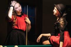 Girl in the billiard room. Two beautiful girls in the billiard room Royalty Free Stock Photos