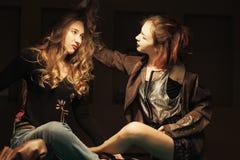 Girl in the billiard room. Two beautiful girls in the billiard room Stock Images