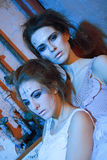 Two beautiful girls in blue and glitter Royalty Free Stock Photography