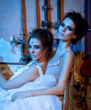 Two beautiful girls in blue and glitter Royalty Free Stock Images