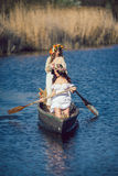 Two beautiful girls in boat Royalty Free Stock Photos