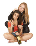 Two beautiful girls with a bottle of wine Stock Photography