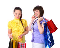 Two beautiful girls with bright packages Royalty Free Stock Photos