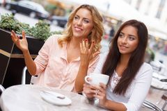 Two beautiful girls in cafe Stock Photo