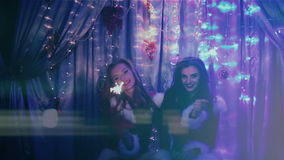 Two beautiful girls with Christmas lights. HD stock footage