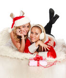 Two beautiful girls at Christmas time Royalty Free Stock Photography