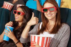 Two beautiful girls at the cinema Stock Image