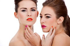 Two beautiful girls with colorfull makeup isolated Stock Photography