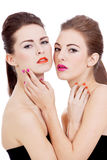 Two beautiful girls with colorfull makeup isolated Royalty Free Stock Images