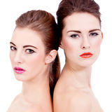 Two beautiful girls with colorfull makeup isolated Royalty Free Stock Image