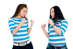Two beautiful girls in combat rack Royalty Free Stock Photo