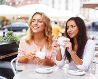 Two beautiful girls with cups Stock Photos